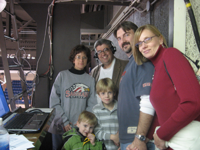 In the broadcast booth with fans of the team